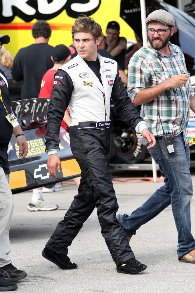 Zac Efron was decked out in a racing suit in Newton, IA, on Friday. He hit the Iowa Speedway track to get started on his next movie, Heartland. Zac's been taking a break from the cameras over the last few weeks and has been spotting hanging out with friends. Zac Efron hit the beach shirtless to celebrate Ashley Tisdale's birthday at the beginning of the month, and he was back on the sand for the July 4 holiday with Brody Jenner. Zac also enjoyed a shopping day with Rumer Willis before heading to the Midwest for work. He's acting alongside Dennis Quaid on this latest project, after sharing the screen with Jessica Biel, Katherine Heigl, Sarah Jessica Parker, and others on New Year's Eve, which will hit theaters this December.