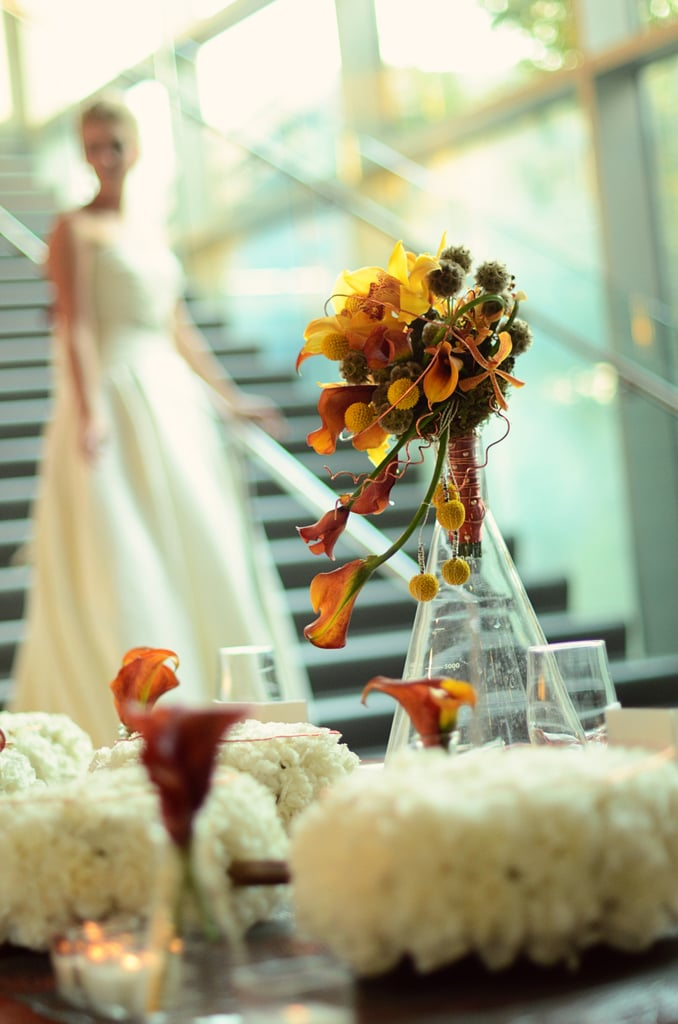 Floral arrangements were placed in glass beakers of various sizes. Source: Mariana Mosli, Kismisink Photography