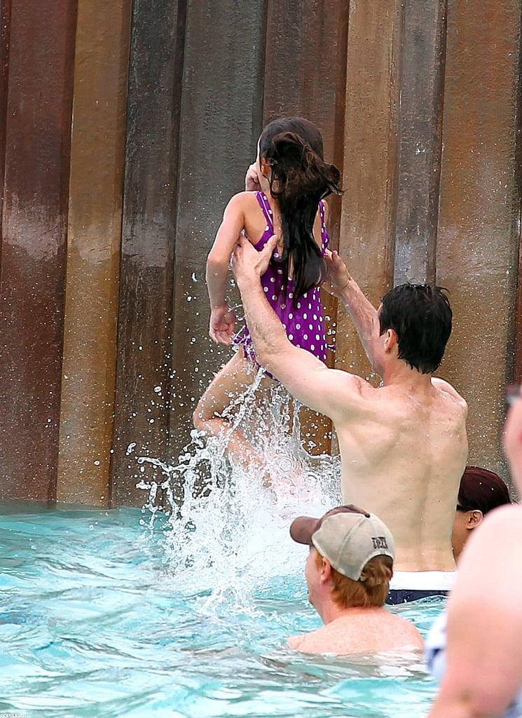 Tom Cruise gave Suri Cruise a toss at the water park.