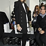 Olivia Palermo continued her flawless front row streak at Antonio Berardi's show in whimsical cat-eye sunglasses and a black and white dress topped with a sleek black coat.