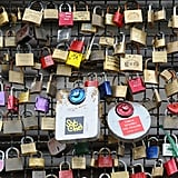 Liebesschloesser, or love padlocks, were affixed to a fence on Hohenzollernbruecke bridge in Cologne, Germany.