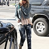 Ashley Tisdale ran errands in LA in bleached denim and a pair of nude Chloé studded booties.