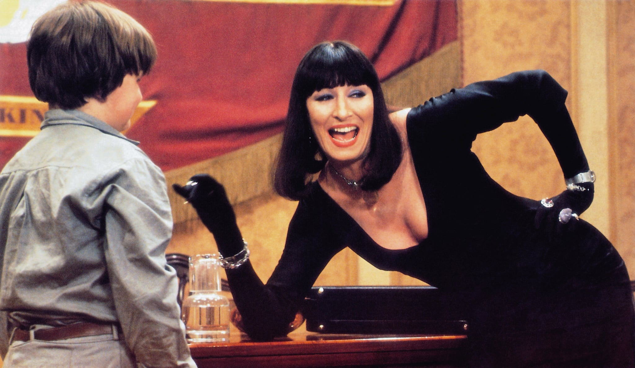 THE WITCHES, from left: Jasen Fisher, Anjelica Huston, 1990,  Warner Brothers/courtesy Everett Collection