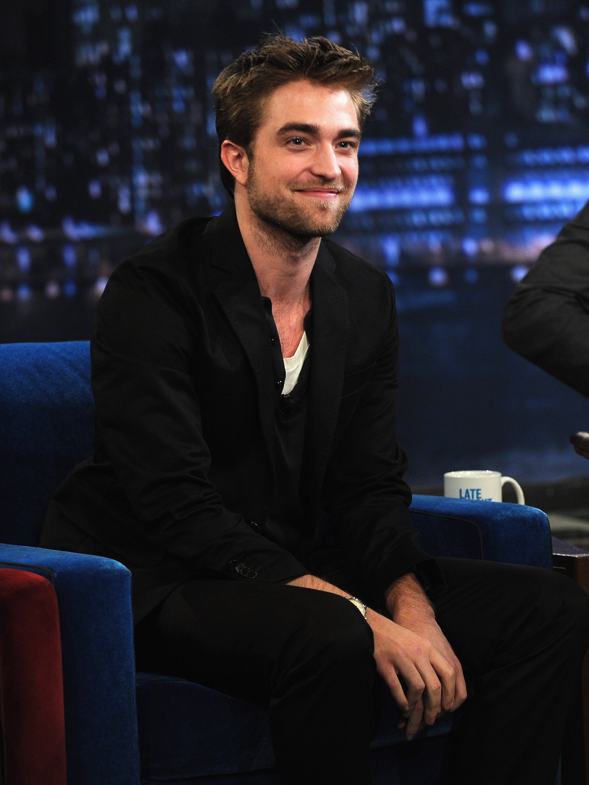 Rob smiled during their chat.