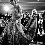 Another heavy Elie Saab gown requires a whole staff to look after it!