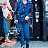 For Gigi's 22nd birthday, Bella turned to her go-to look of denim on denim. This time, she wore embroidered rose patterns on her Adam Selman jacket and jeans.