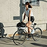 Show off your legs Hanneli Mustaparta-style in a formfitted black leather skirt, then tuck in a slouchy white tank — T by Alexander Wang has a great selection! — for a cool-girl finish.