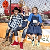 Gwen and her boys showed off their charitable side and volunteered at the Feeding America Holiday Harvest fundraiser in LA back in October 2015.