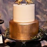 This modern cake has a bit of whimsy with graphic gold detail that pops against the cake's white fondant.
