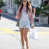 Alessandra Ambrosio looked festival ready on the streets of LA in her short overalls and pink top.