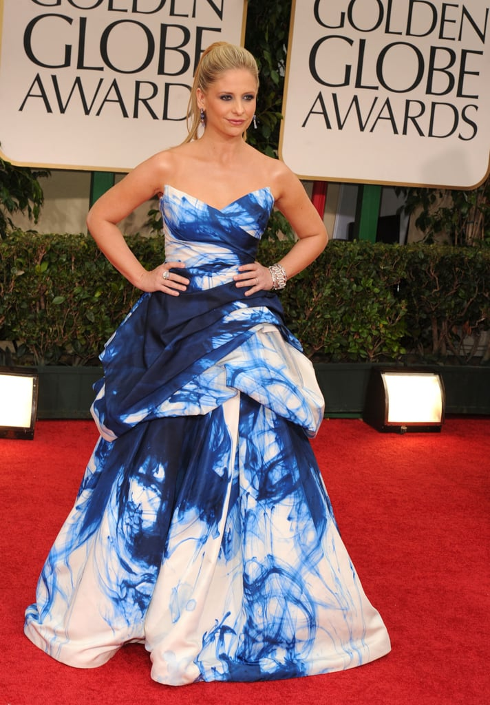 Sarah Michelle Gellar in a blue and white dress on the red carpet.