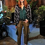 Taylor Tomasi Hill brought her brand of eclectic-cool styling to the Ostwald Helgason presentation, layering a printed jacket with a pajama-style button-down, crisp trousers, and sleek white ankle-straps.