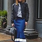 On Editor Sarah Wasilak: Aritzia jacket, La Ligne skirt, Fendi bag, Adornmonde earrings, Steve Madden shoes, and sweatshirt editor's own