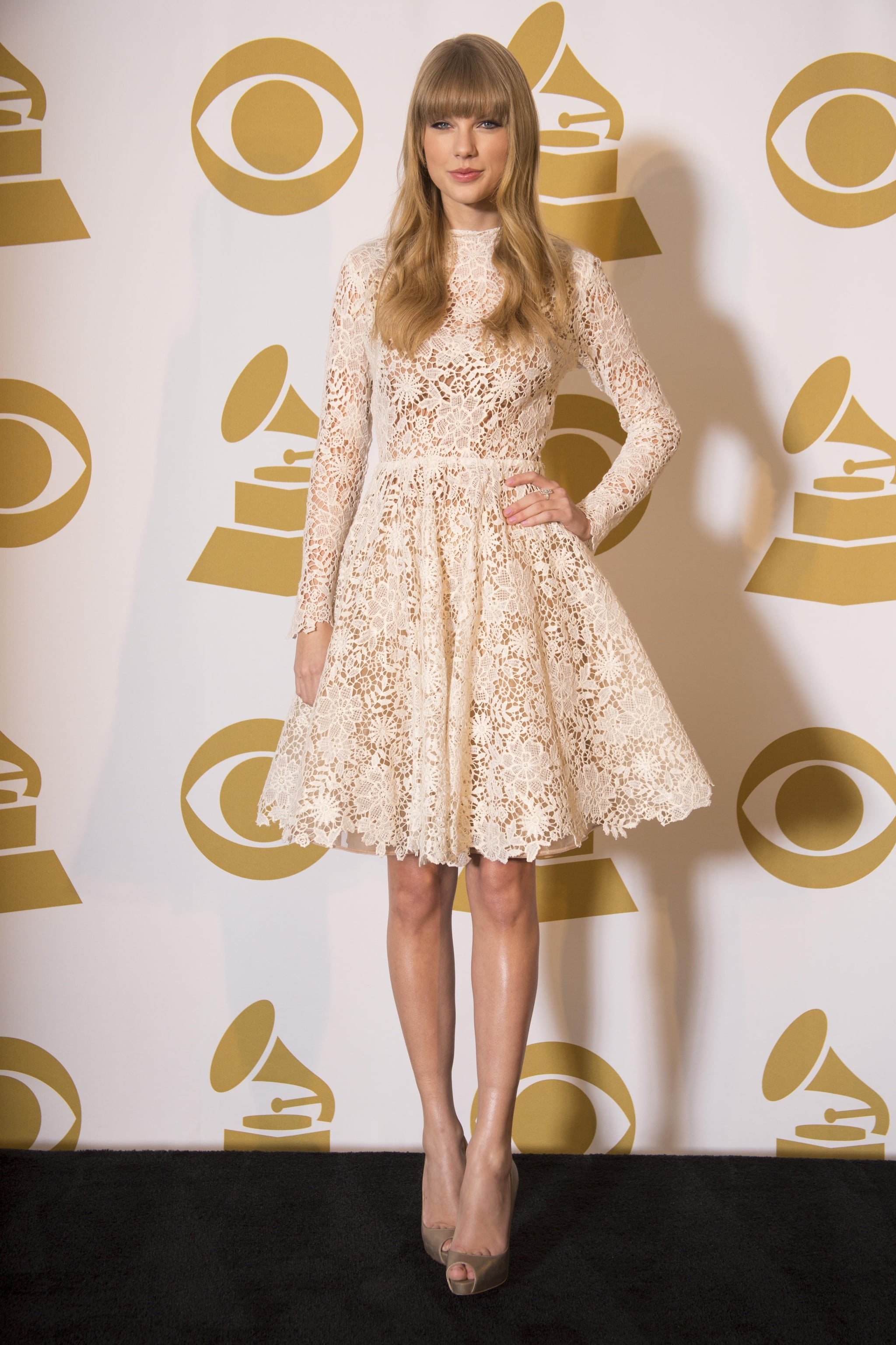 Taylor Swift wore a lace dress at the Grammy Nominations concert in Nashville.