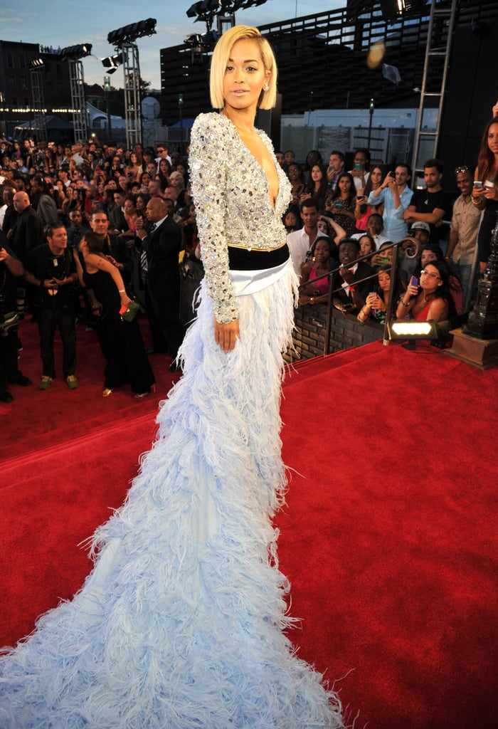 Rita Ora made a grand entrance in an embellished Alexandre Vauthier Fall 2013 Couture gown featuring a plunging neckline and an over-the-top feathery skirt and train.