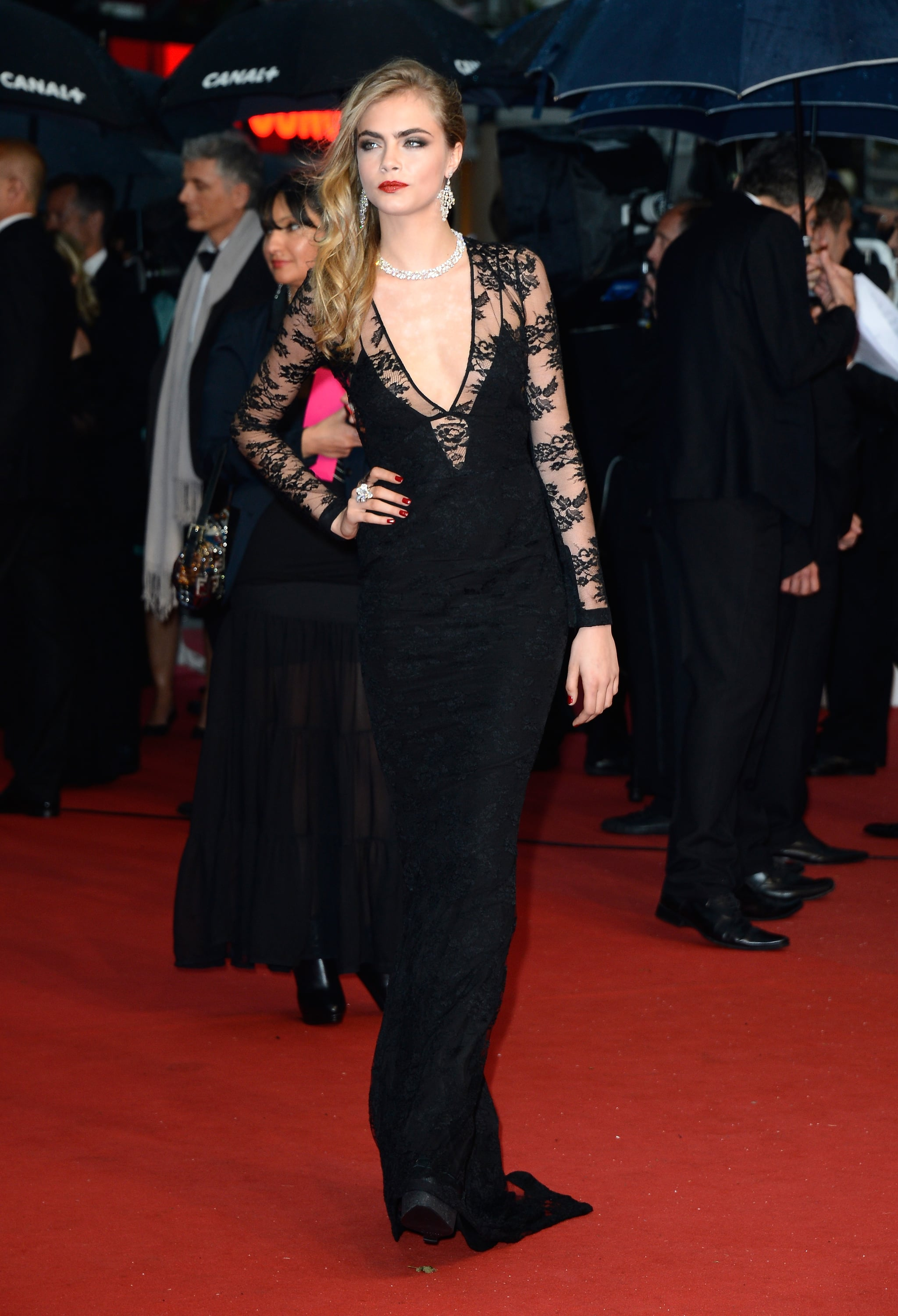 Cara Delevingne amped up the sex appeal in a body-con Burberry gown with a plunging neckline at the 2013 Cannes Film Festival.