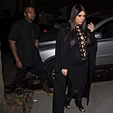 Per usual, Kanye hung back in his more understated outfit and let Kim take the focus.