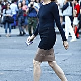 Carine Roitfeld kept it slick, per usual, in a fitted pencil skirt and long-sleeved tee, styled up with a pair of visor shades and striking white heels. Source: Greg Kessler