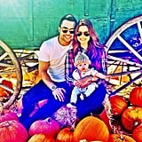 New to Instagram, Joanna Garcia Swisher snapped a shot of husband Nick, daughter Emerson, and herself at the pumpkin patch.  Source: Instagram user jogarciaswisher