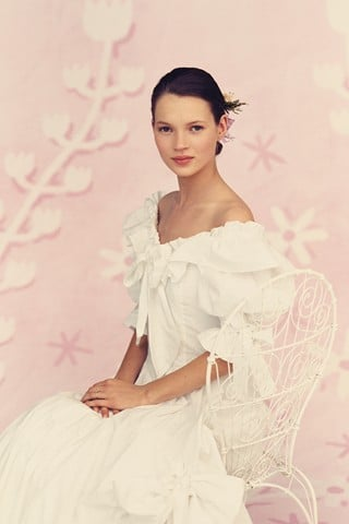 >> It's one short month until Kate Moss marries her fiance Jamie Hince, and as the wedding day nears, Brides UK dug up some images of Moss modeling wedding dresses way back in 1991, when she was 17. The five-image photoshoot aimed to show off the year's best bridal fashions priced at under 500 pounds.