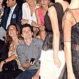 Orlando Bloom smiles at his wife Miranda Kerr.