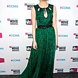 Emma Stone smiled in her green Jason Wu dress.