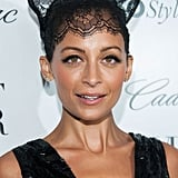 Donning lace cat ears, Nicole Richie got in the Halloween spirit at Who What Wear's 50 Most Fashionable Women of 2013 event. She completed the look with thick black liner for a flirty effect.