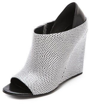 Alexander Wang's Alla wedge bootie ($715) has the comfort of a wedged heel married with a subtle flash of print. Add these to a sleek LWD for a more modern, dressed-up feel.
