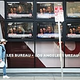 The hearing appears on TVs on the street in Los Angeles.