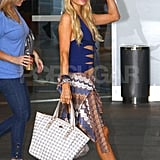 Paris Hilton gave a wave in her blue bathing suit with cut-outs in Australia.