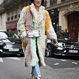 Eva Chen wore her shaggy coat with cropped jeans and heels.