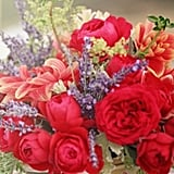 An old lunchbox or tin box makes a great vase alternative, especially if you want a low arrangement. Just place a rectangle of floral foam inside the box to keep the stems all in place. Source
