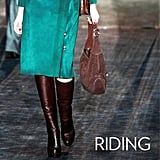Why we love them: Riding boots allow you to look like the epitome of equestrian chic, even if you've never been on a horse in your life. They're comfortable, easy to get into, and have a simple, classic silhouette. How to wear them: Riding boots are, of course, made to be worn with slim-fitting tailored pieces — opt for a pair of dark-wash skinny jeans or trousers, then go a bit fuller on top, like with a printed blouse or slouchy tee. For the ultimate in polo-cool, add a fitted blazer with elbow patches.  Shop the runway: Gucci Trish High-Heel Riding Boots ($1,795)