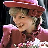 On a trip to visit Chinatown in Liverpool, UK, the princess sported a a Bellville Sassoon pink maternity coat with a high collar — a look she obviously favored — and a John Boyd hat to match.