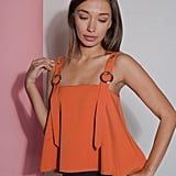 """Being rather small (and small chested at that), I'm always looking for tops that fit just right. Petite Studio offers women my size the chance to wear some pretty trendy looks. I love the orange shade of the Clementine Buckle Top ($79), but especially the adjustable buckle detail at the sleeves."" — Sarah Wasilak, editor, Fashion"