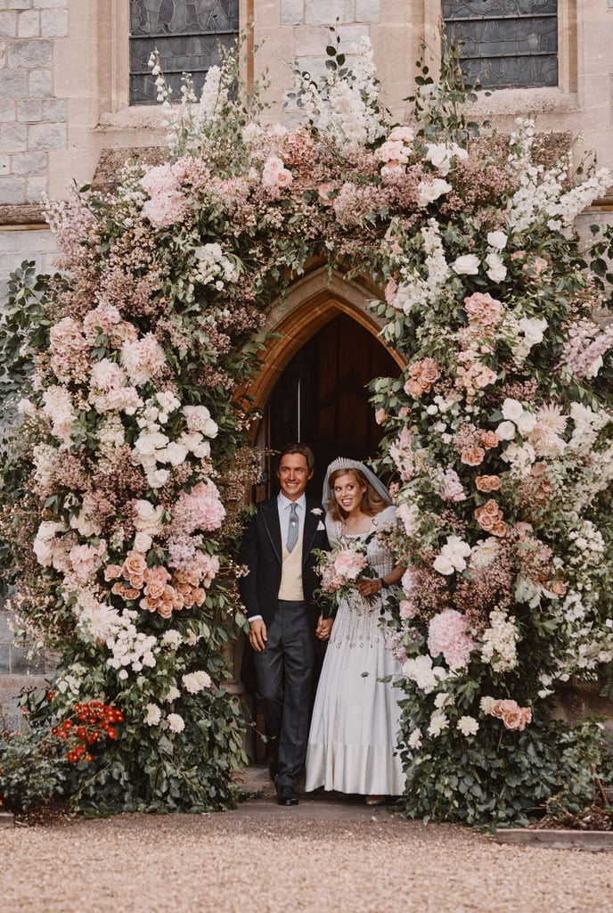 "Princess Beatrice and Edoardo Mapelli Mozzi's beautiful royal wedding photos are here, just a day after they quietly tied the knot on July 17. The couple beamed as they exited the Royal Chapel of All Saints at Royal Lodge in Windsor under a floral archway and posed at a distance with her grandparents, Queen Elizabeth II and the Duke of Edinburgh. They celebrated the special day with 20 of their closest friends and family.  A spokesman for Buckingham Palace said: ""The private wedding ceremony of Princess Beatrice and Mr Edoardo Mapelli Mozzi took place at 11am on Friday 17th July at The Royal Chapel of All Saints at Royal Lodge, Windsor. The small ceremony was attended by The Queen, The Duke of Edinburgh and close family. The wedding took place in accordance with all relevant Government guidelines."" Congrats to Beatrice and Edoardo!"