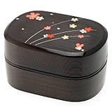 A spray of cherry blossoms decorate this faux wood bento box ($24) — but it's still dishwasher- and microwave-safe.