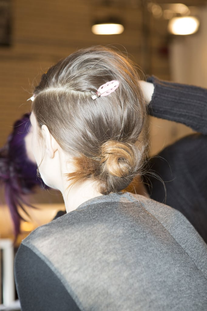 "For hair, Redken Creative Consultant Guido also took his cues from the '60s, the centerpiece of the look being a deep side part à la Edie Sedgwick. ""I like to soften everything by pulling a little bit in the crown so it's a little '60s, but not too exaggerated,"" he explained. ""The whole thing is very soft and easy. The real star is the clean part, so the rest can be disheveled."""
