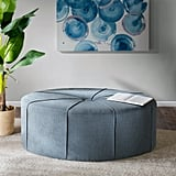 Telly Oval Tufted Cocktail Ottoman