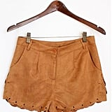 We're imagining these suede shorts with a breezy white tank and flat sandals for Coachella.  Mickey's Girl Faux Suede Scallop Shorts ($34)