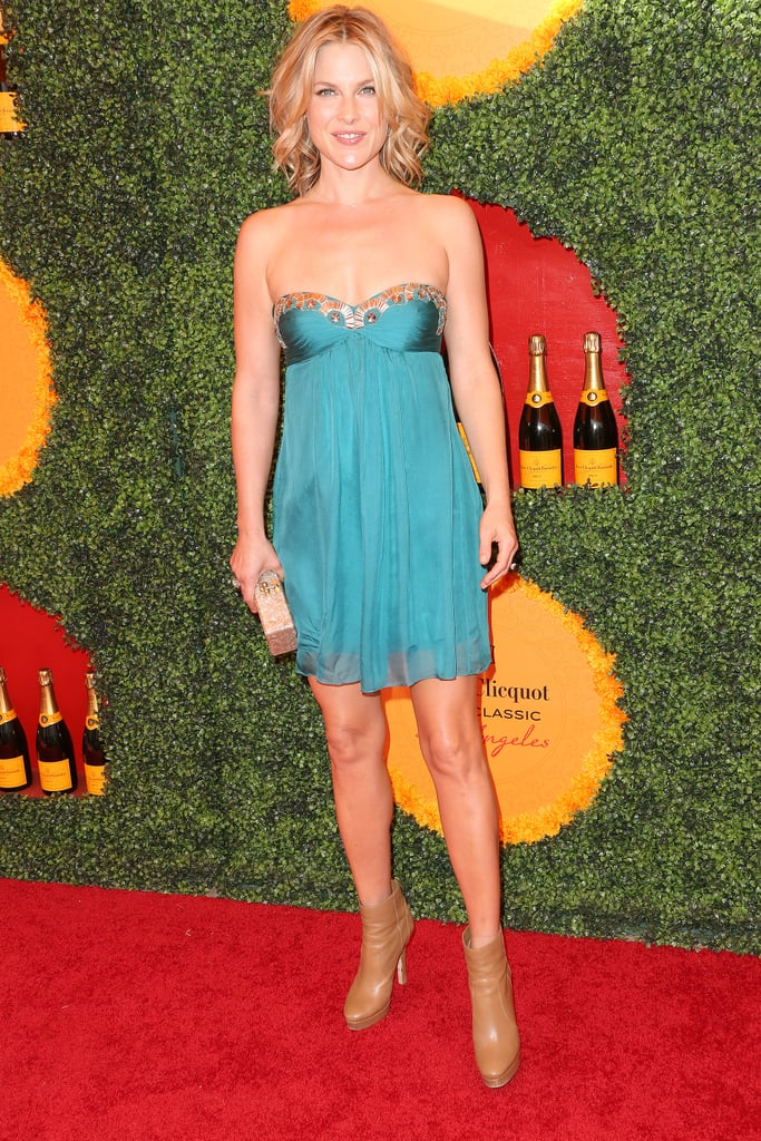 Ali Larter played with proportions by styling a teal sweetheart-shaped strapless dress with chunkier tan ankle boots.