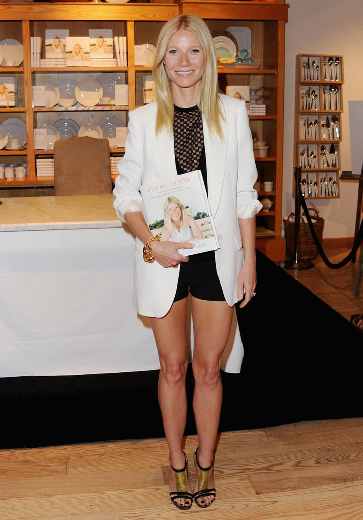 "Gwyneth Paltrow popped up at a Williams-Sonoma store in Beverly Hills to sign copies of her new cookbook, It's All Good: Delicious, Easy Recipes That Will Make You Look Good and Feel Great, on Friday. She showed off her legs in a pair of short black shorts, which she paired with a long white blazer for her latest appearance to promote her new collection of recipes. Gwyneth had the support of husband Chris Martin and her kids, Apple and Moses, for another signing at an LA Barnes & Noble on Thursday, and she is headed to the East Coast for her next promotional stop at Williams-Sonoma in NYC tomorrow. For her recent press duties, Gwyneth has been able to show off her fit figure, which she credited to workouts with her pal and trainer, Tracy Anderson. At the launch of Tracy's new flagship studio in Brentwood last week, Gwyneth compared her butt to that of a ""22 year-old-stripper,"" referring to a compliment she received from a friend. She joked, ""You know, this isn't so bad for 40, right? And [my friend] goes, 'It's not so bad for a 22-year-old stripper!'"" Gwyneth had a busy weekend as she celebrated Moses's birthday with a star-studded party in LA on Saturday. Celebrity guests included Cameron Diaz, Gwen Stefani, and Tobey MaGuire."