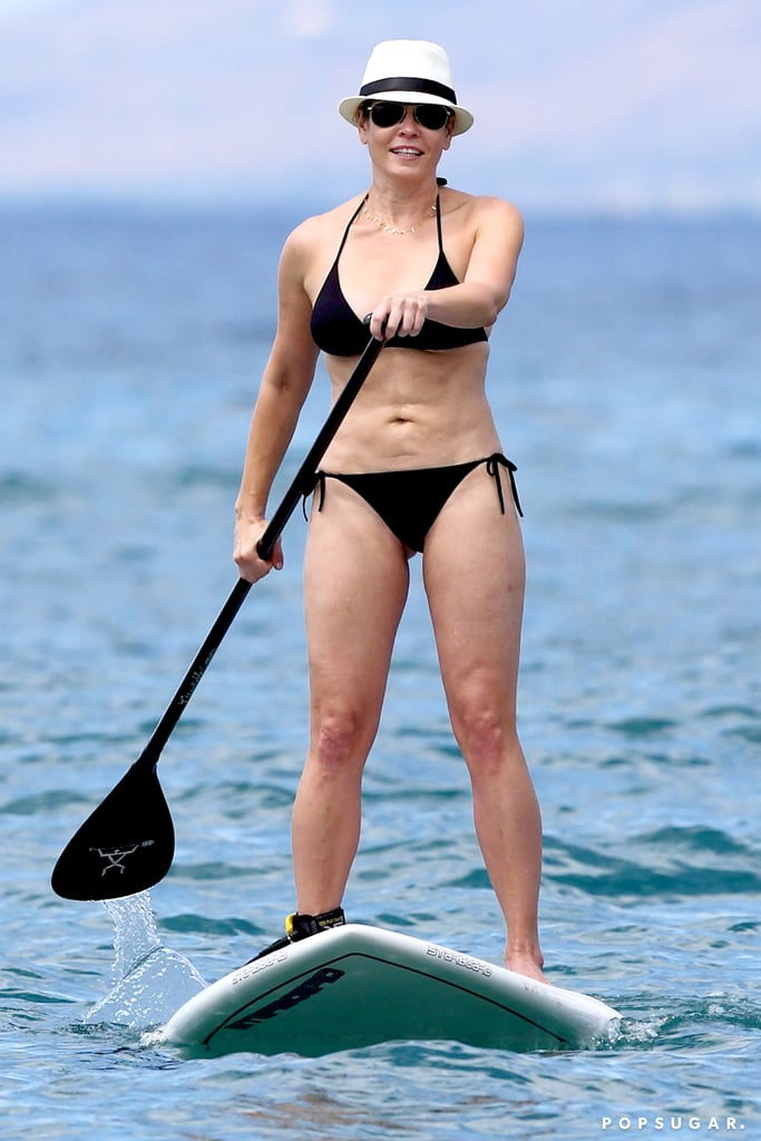 "Chelsea Handler showed off her bikini body on Thursday while spending time at the beach in Hawaii. The comedian sported a hat and sunglasses with her black swimsuit, and she was all smiles as she paddleboarded through the water before walking along the beach. Last week, the late-night host put her girlfriend Gwyneth Paltrow in the hot seat, asking Gwyneth about her sex addiction when the actress stopped by her show, Chelsea Lately. Her pal took it in stride and turned the tables back on Chelsea, saying, ""Well basically I was a really normal person, and then I started hanging out with you all the time."" Take a look at the funny lady's low-key beach day!"