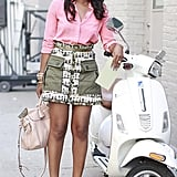 Teen Vogue editor Shiona Turini added the perfect soft touch to her military hues with a crisp pink blouse. Just accessorize with neutral accessories, and you're set! Continue clicking to get the look.