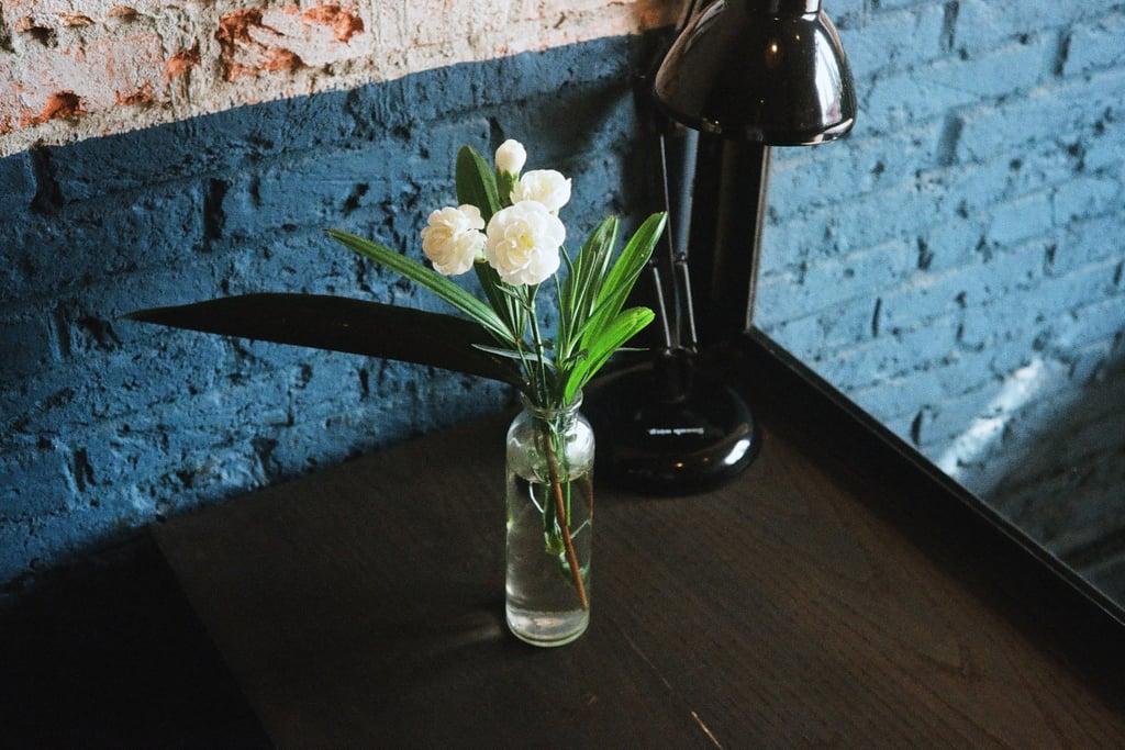 Arrange flowers in a vase.