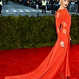 Maggie Q's fiery red Prabal Gurung gown mixed glamour with sex appeal, thanks to a long train and sheer inserts at the side and shoulders.
