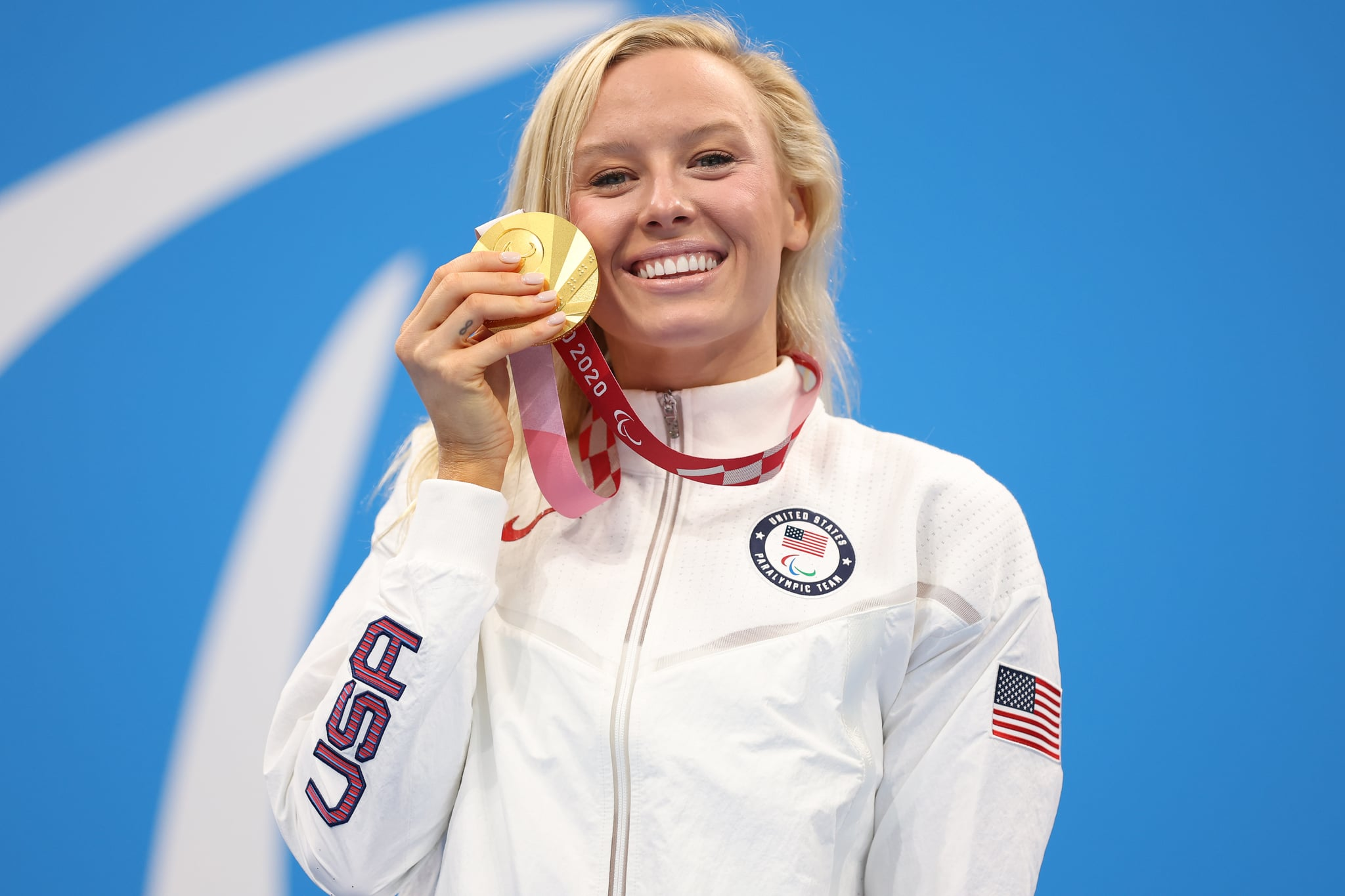 TOKYO, JAPAN - SEPTEMBER 03: Gold medalist Jessica Long of Team United States celebrates during the medal ceremony for the Women's 100m Butterfly - S8 Final on day 10 of the Tokyo 2020 Paralympic Games at Tokyo Aquatics Centre on September 03, 2021 in Tokyo, Japan. (Photo by Alex Pantling/Getty Images)