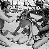 How's this for a throwback? Kirk Douglas braided 19-year-old Brigitte Bardot's hair on the beach in 1953 — the two starred together in the film Act of Love.