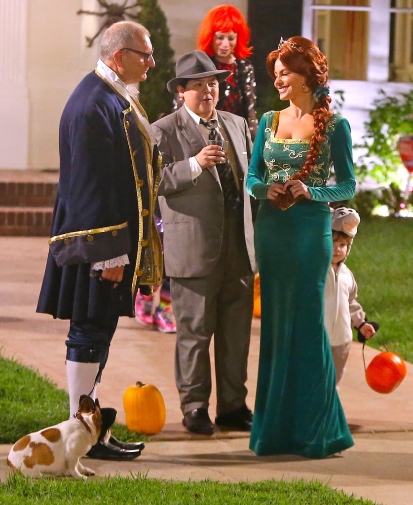 The Modern Family cast got a head start on Halloween this week when they filmed scenes for their their annual spooky-themed episode in LA. Sofia Vergara grabbed the most attention in her Princess Fiona costume from Shrek, and her new look proved to be a hit with her boyfriend, Joe Manganiello, who dropped by the set to chat and show PDA with his love. Meanwhile, Ed O'Neill donned a late 18th century ensemble, while Julie Bowen and her onscreen kids looked like scary hospital workers and patients. However, Ty Burrell avoided the scary patient theme that the rest of his onscreen family was going for and instead wore a colorful rainbow suit. As for what exactly is going on in the pictures, we'll have to wait for the show to air to get the full picture. In the meantime, Modern Family fans can get their fix by checking out pictures for the show's sixth season premiere, which will air on Sept. 24.