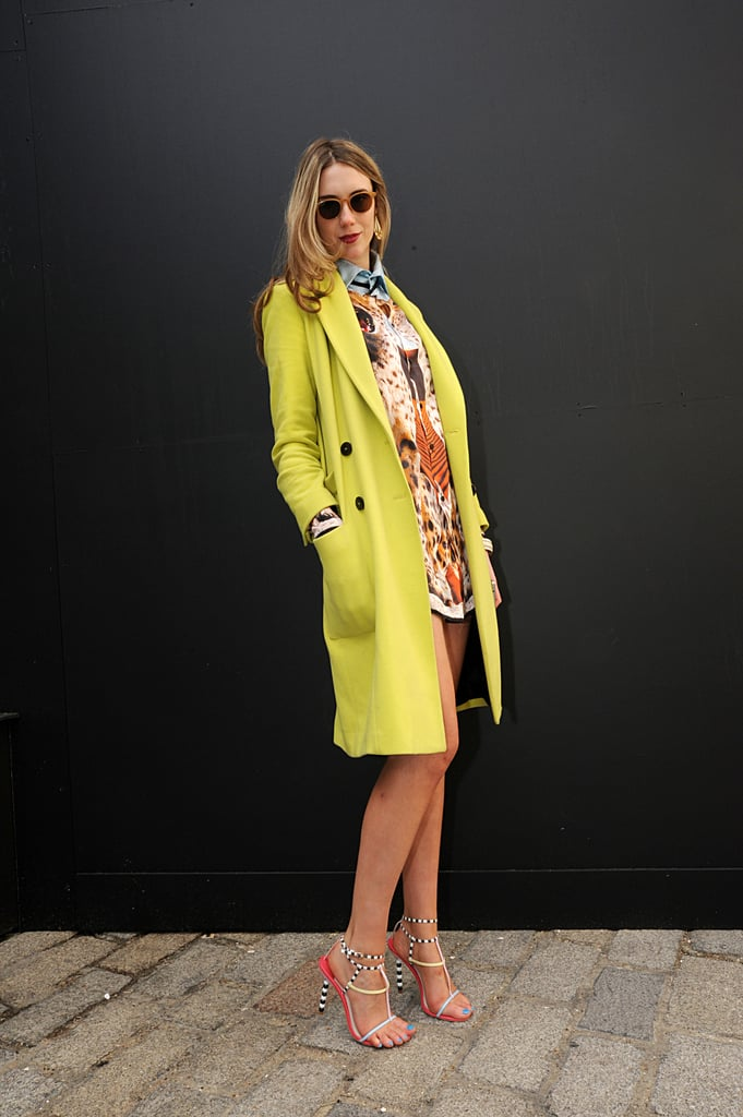 Citron outerwear added oomph to a printed dress and high-wattage heels.